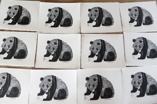 table_of_panda_linocuts