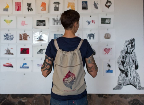 Hilary Lorenz wearing a hand printed linocut Pisces backpack
