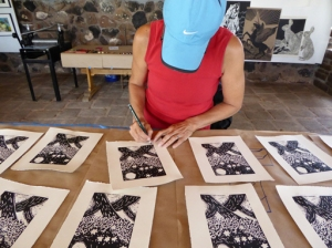 Michelle Holland signing her prints